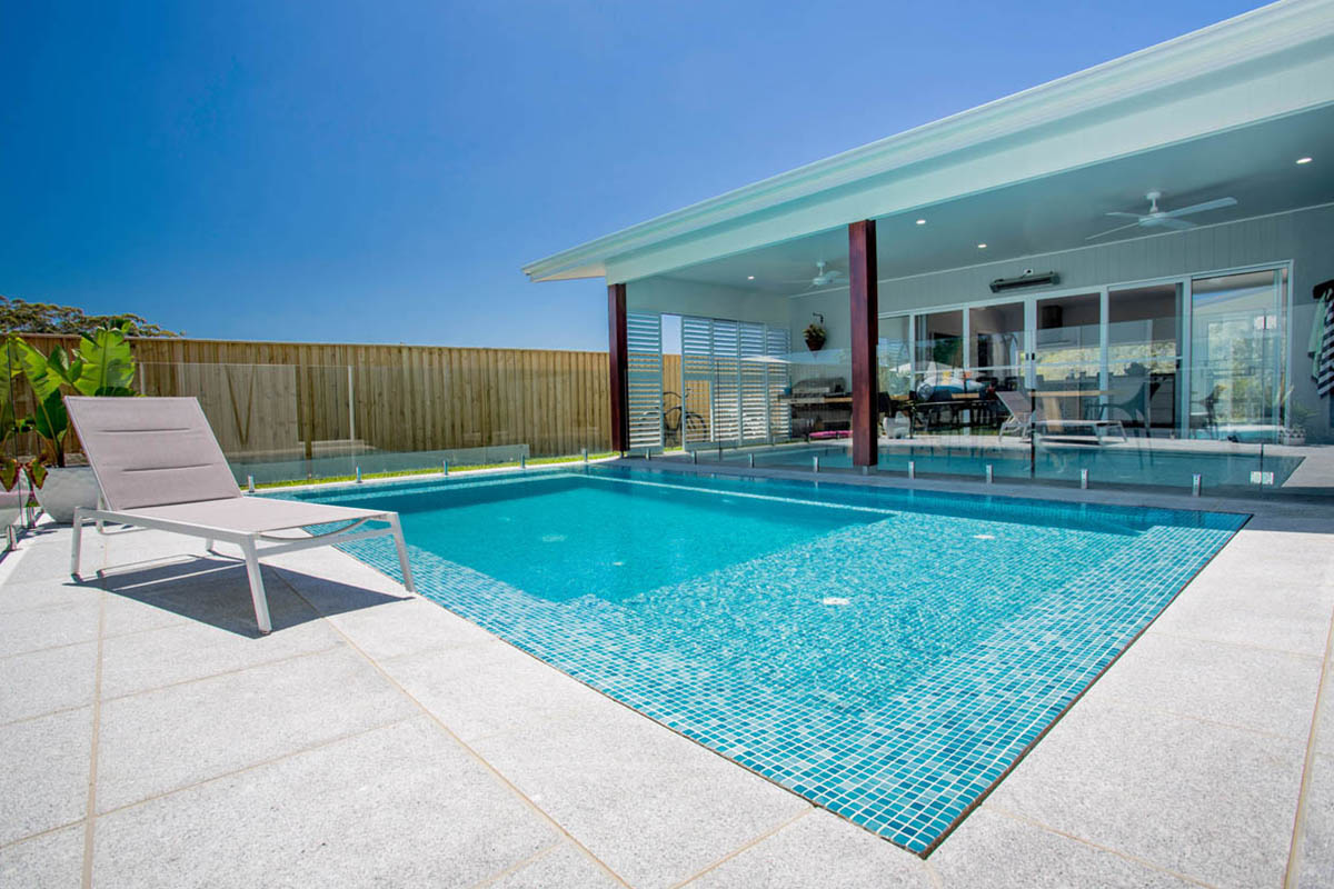 North sapphire slot deck tiled pool atlas pools for Pool area design photos